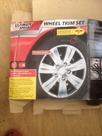 "Set of 15"" car wheel trims new"