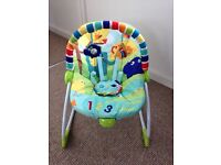 Brights Stars Baby Rocker, with mobile. Gently vibrates & can be rocked back & for.
