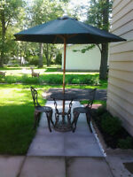 Wrought Iron table, 2 chairs, umbrella and stand - Fort Erie