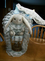 BUNNY SITTING ON A WICKER CHAIR