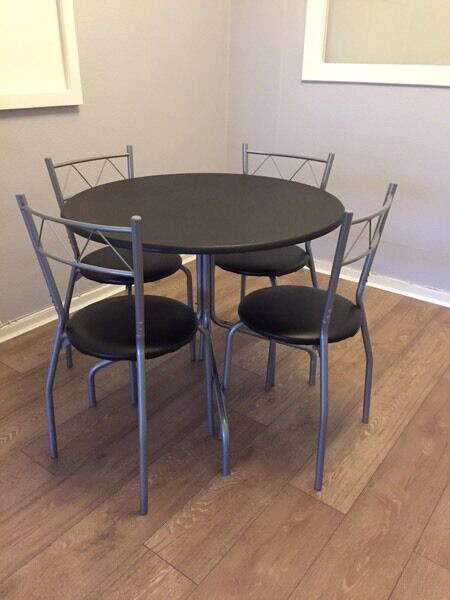 Black and grey, round table and 4 chairs