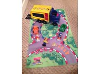 Fisher price car transporter with cars and race drivers
