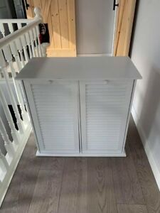 White laundry hamper/storage unit.