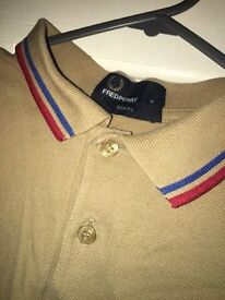 Fred Perry polo shirt.
