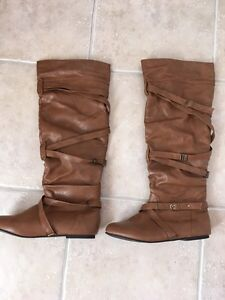 Brown and black high boots