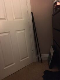 Two black metal IKEA curtain poles with fittings