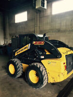 "2011 New Holland ""L230"" skid steer"