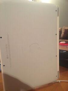 Macbook White - Good Condition Laptop. Rockingham Rockingham Area Preview