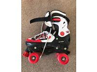 Adjustable roller skates (size 4.5-6)