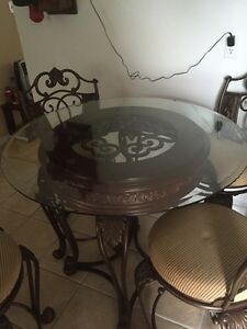 Metal dining room table Top is glass With 4 swivel chairs Cambridge Kitchener Area image 3