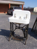 Antique sink and taps mounted on sewing machine base