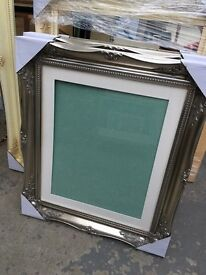 large silver swept wooden frame with mount