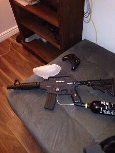 Paintball gun with 24 oz tank and paintballs