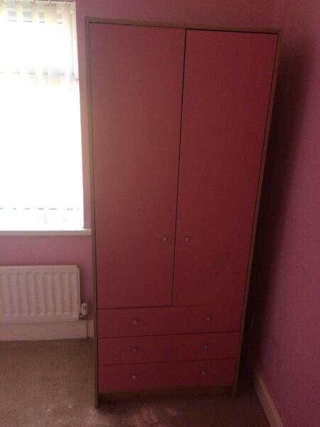 Pink wardrobe with draws