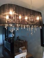 Two chandelier and one table lamp