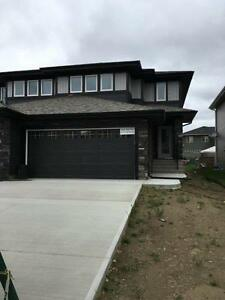 BRAND NEW DUPLEX, PRICE REDUCED TO SELL! MOVE IN WITHIN 30 DAYS!