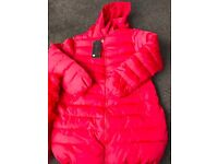 Brand new coat with tags Removable fur trim on hood
