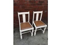 2 leather padded chairs
