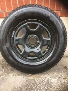 4 Michelin Latitude X-Ice 235/70R16 winter tires on rims