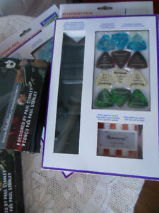 Accessory packs for guitars, (12 picks, strap, pitch pipe) London Ontario image 4