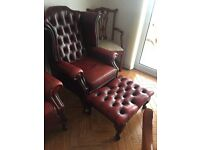 Two leather armchairs and footstool