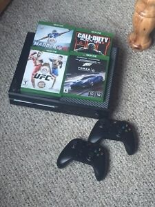 Xbox one console, with 2 controllers and 4 games.  $350 Obo
