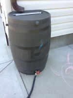 Rain barrel and (brass) spigot with black rubber hose