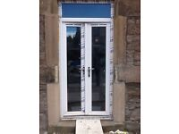 PAIR OF CAST STONE WINDOW OR DOOR SURROUND