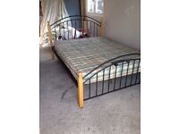 "King size ornate metal and solid wood bed from ""NEXT"""