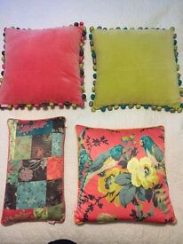 4 pillows and bedspread