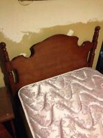 Single bed with mattress, side table and two dressor set.  Solid