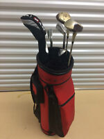 Older Red Golf Bag with Club includes tees and rain cover.   Se