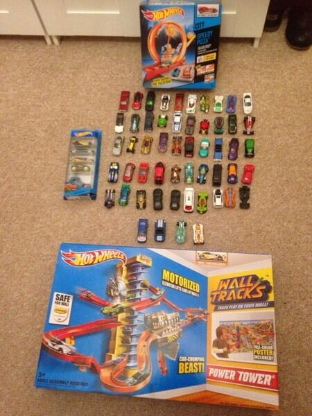 60 hotwheels cars & 2 new boxed tracks & new 5 pack of dino riders cars.