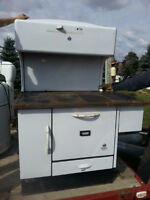 Antique Stoves, heaters, dressers, washing machine  and cabinets