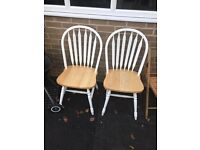 Two solid pine dining chairs
