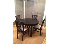 Dining Table. Round Extendable into Oval & 4 Chairs.