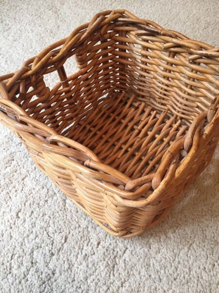 Wicker basket 25cm x 25cm by 16cm deep well made with a handle on one side