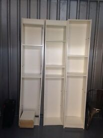 Three book shelves with extra shelves included