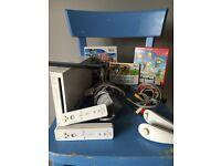 Nintendo Wii bundle with super smash bros brawl, super mario bros, and woo sports