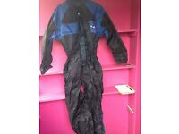 Motorbike All in one shower suit folds into bum bag. Size small.
