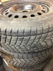 225/65R17 9/32 winter tires with rims