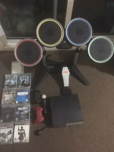 500GB PS3 w/ 9 Games, Microphone, Drums/Guitar + PS Move