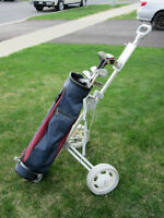 Men's right hand golf clubs.