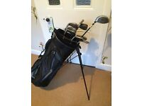 Full set of golf clubs with bag.