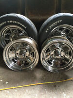 four 5 bolt, 15 in. crome mag rims wath rear tires only for $350