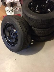 245/60/18 Michelin X-ICE2 winters on OEM Ford rims 90% life
