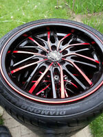 four 18 inch rims with tires for sale. bold pattren 5x114.3