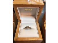 Platinum engagement ring pear shape size K