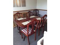 Solid mahogany extending table and chairs