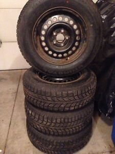 Uniroyal tiger paw winter tires on 5 bolt 100mm rims  Kitchener / Waterloo Kitchener Area image 1